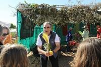 Rabbi Dan Goldblatt instructs in the use of ritual items at last years Sukkot Festival.
