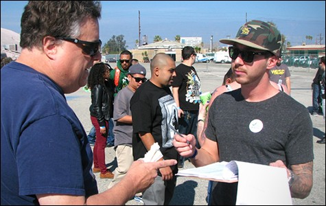 A California resident and Cannabis Cup attendee hesitates to sign a 2014 pot legalization petition Feb. 8, citing a need for more information