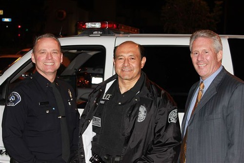 Sen. Lou Correa (center) and the police are not doctors, but they play them on the Senate floor